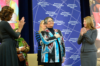 First Lady Michelle Obama Embraces 2014 IWOC Awardee Oinikhol Bobonazarova of Tajikistan